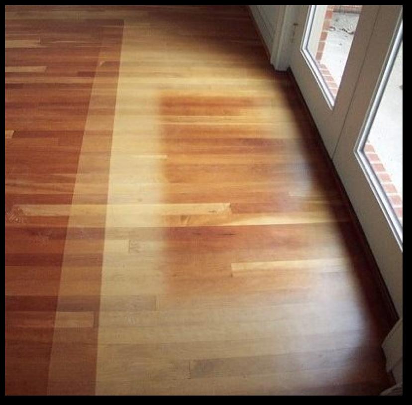 Faded hardwood flooring in front of double doors