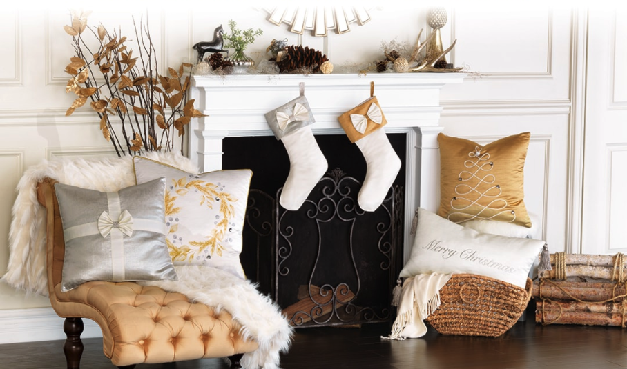 Eastern Accents fireplace holiday decor with decorative pillows and stockings