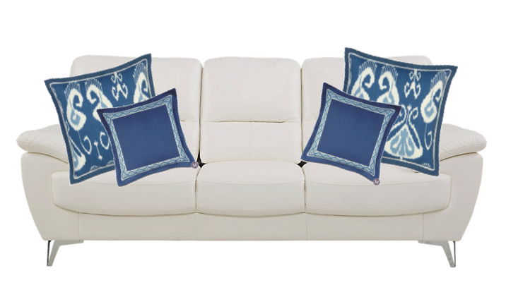 solid white sofa with blue decorative pillows of varying prints