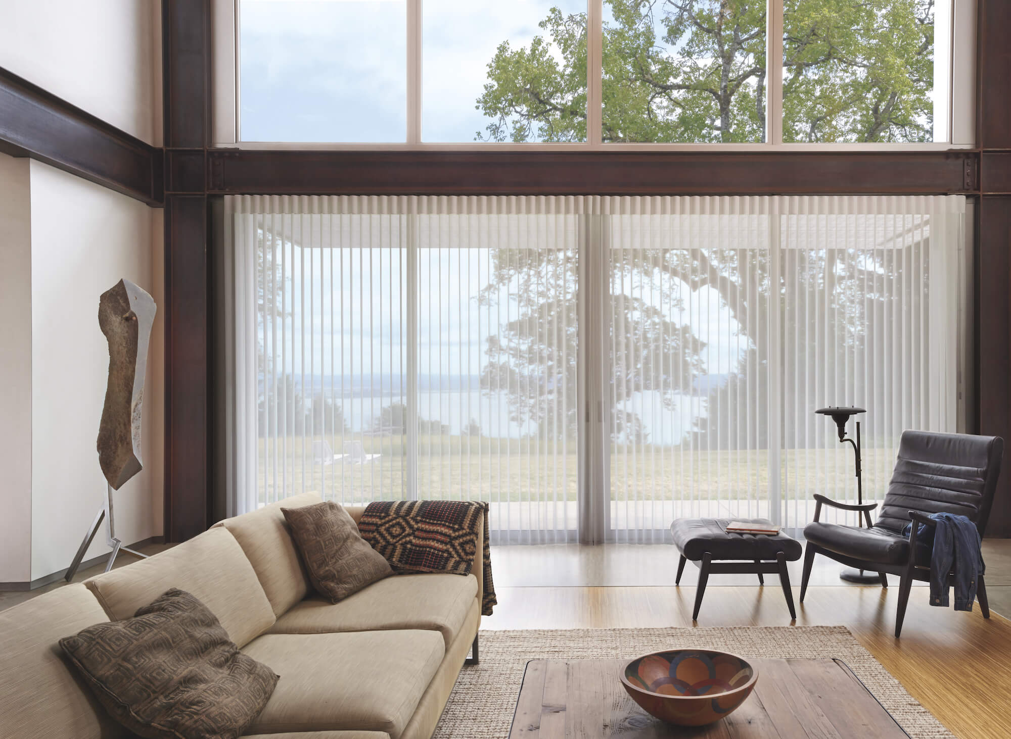 LuminettePrivacy Sheers vanes tilted open to lake front view