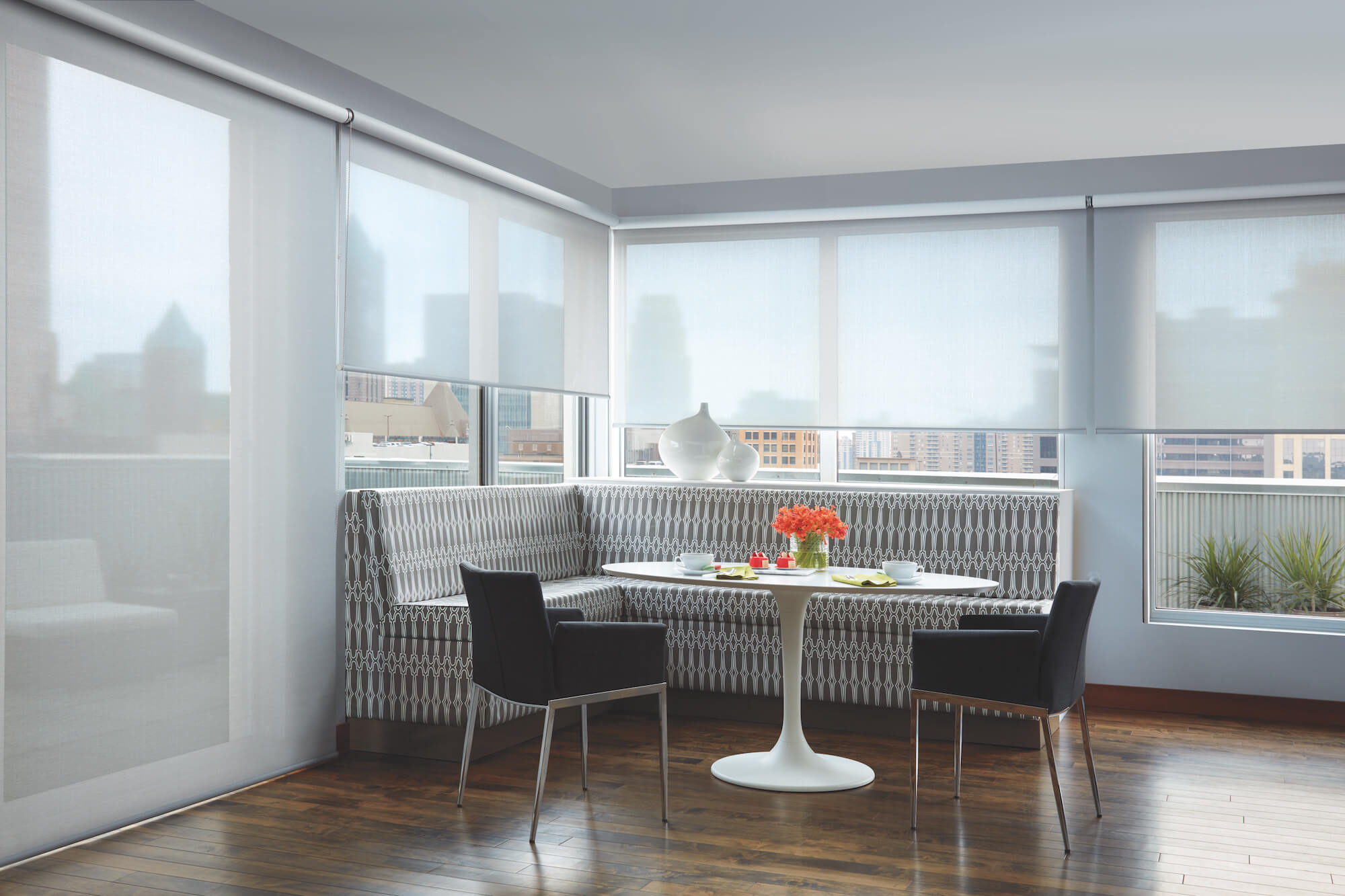 Designer Screen Shades on wall of windows looking out to city-front view