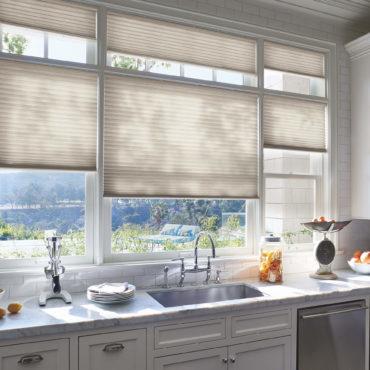 Hunter Douglas Duette Honeycomb shades behind kitchen sink