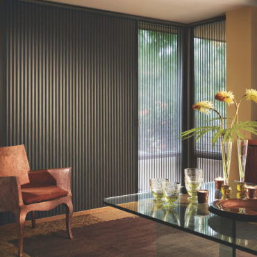 duette vertiglide shades on sliding glass door in dining room