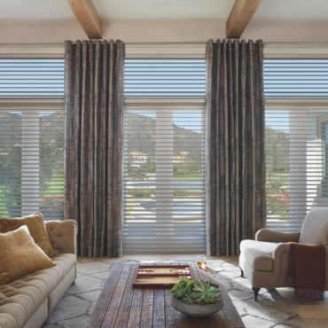 living room with floor to ceiling Hunter Douglas Silhouette Window Shadings