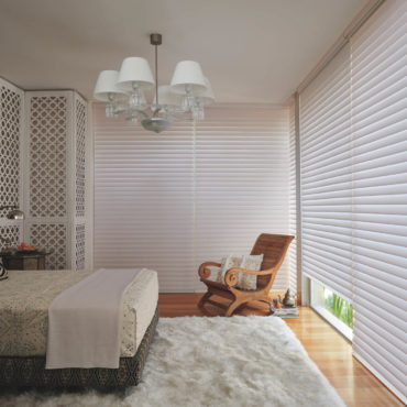 bedroom with floor to ceiling Silhoutte window shadings closed