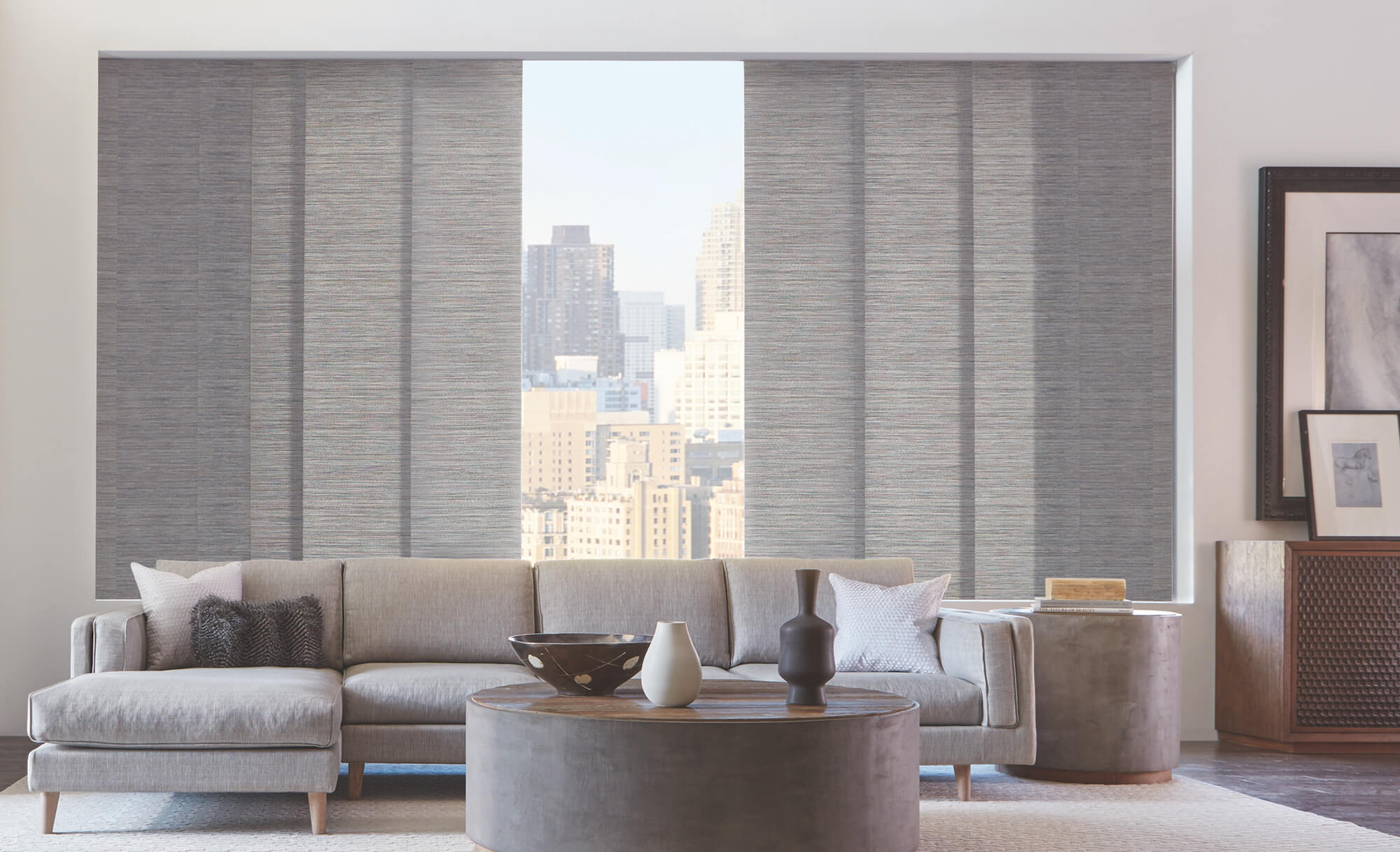 Living Room Skyline Gliding Window Panels opening to city view