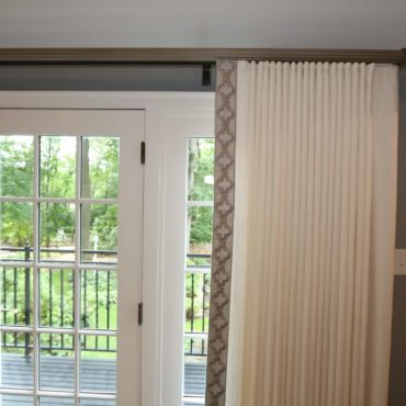 white custom draperies on French Door to front porch