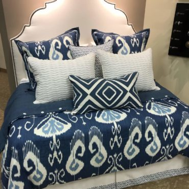 blue Eastern Accents custom bedding on demo bed