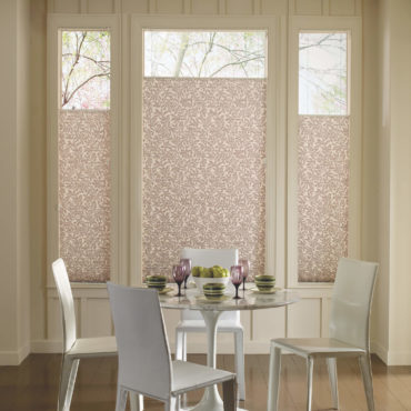 Hunter Douglas pleated shades on dining room bay window