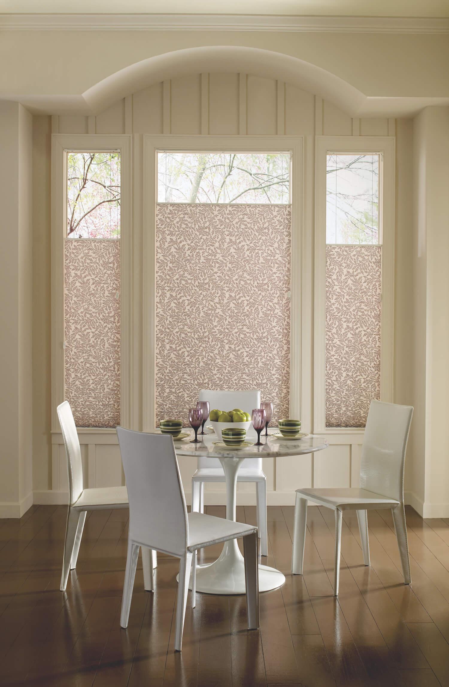 Hunter Douglas pleated shades on dining room bay window