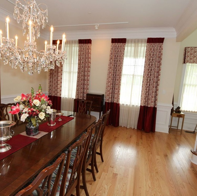 floor to ceiling custom drapery panels and sheers in dining room