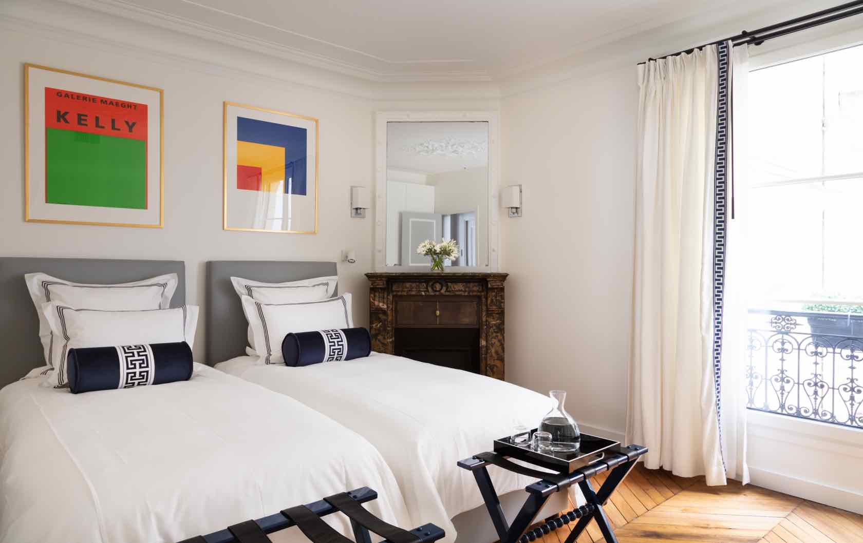 Paris Apartment bedroom space with custom floor-length drapery