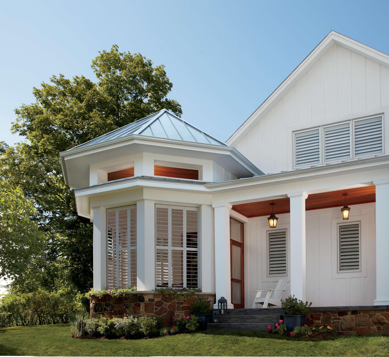 Exterior of home with custom Hunter Douglas interior plantation shutters