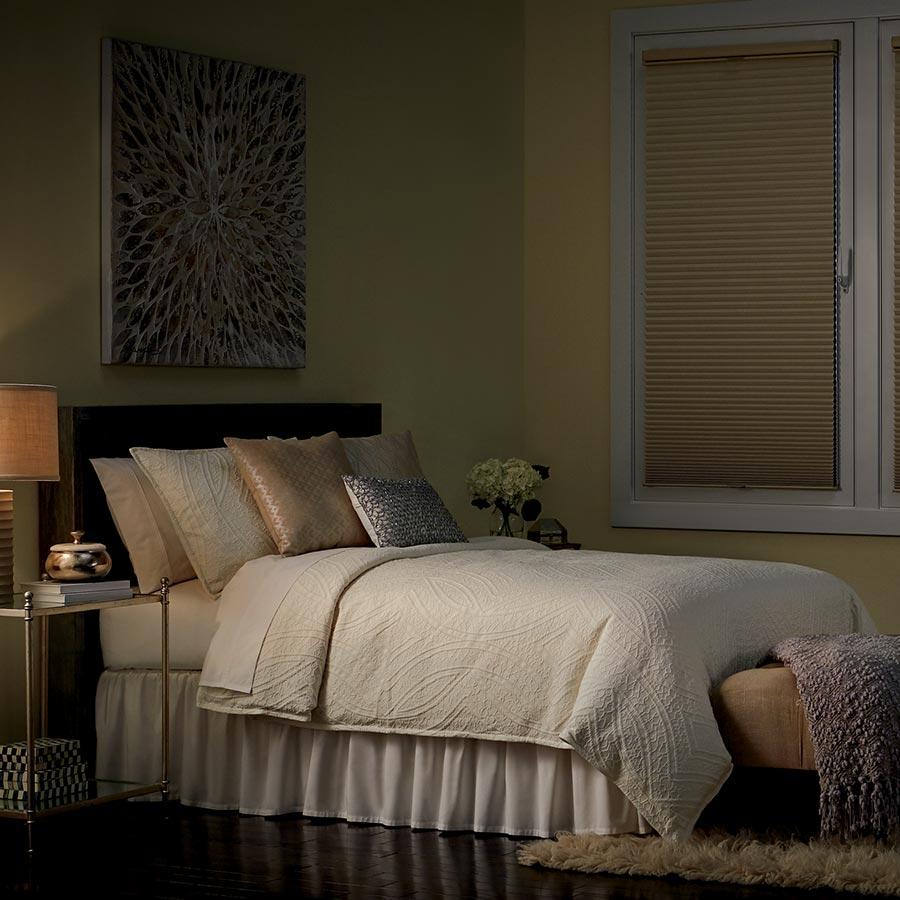 gray drapery panels on corner window with wood blinds