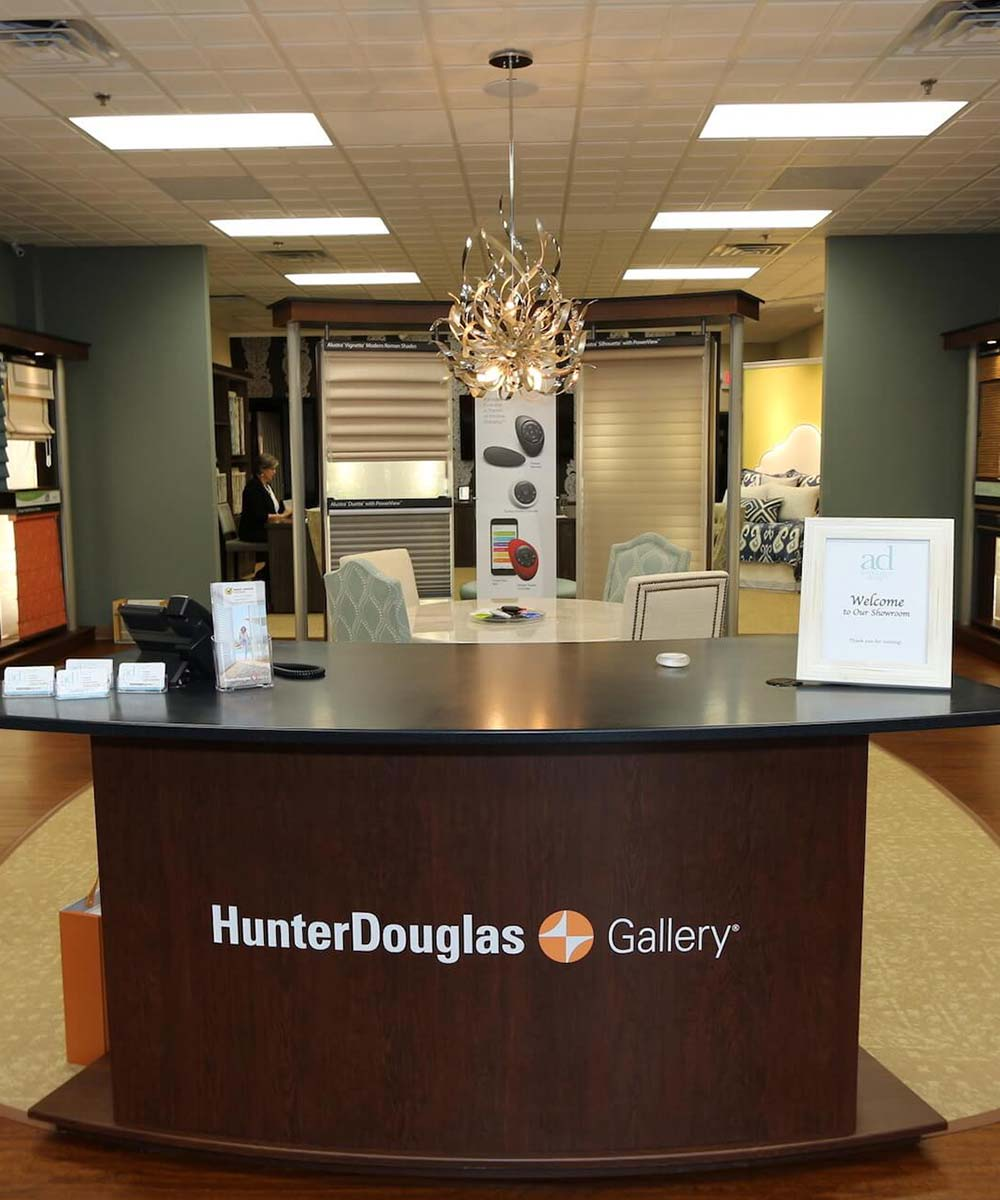Hunter Douglas faux wood blinds behind kitchen sink